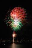 Fireworks. Colourful fireworks at night over water by Sydney harbour royalty free stock image