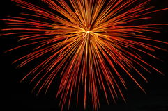 Fireworks. Red starbust illuminating the night sky Royalty Free Stock Image
