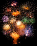 Fireworks. Bouquet of multiple fireworks bursting in all kinds of forms and colors stock images
