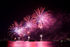 Fireworks. Pyrotechnic display shot from a barge with nice water reflection of the fireworks Royalty Free Stock Photography