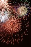 Fireworks. Colorful fireworks display on New Years night Royalty Free Stock Photography