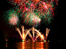 Fireworks. Over water on a black Stock Photo