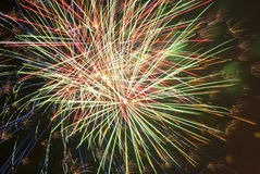Fireworks. In shades of white, green, blue, orange, red Stock Image