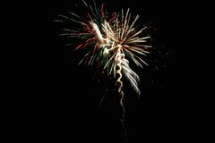 Fireworks. At night in the black sky Stock Images