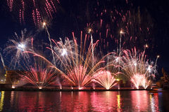 Fireworks. Colorful festival fireworks at the river royalty free stock image