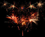 Fireworks. Of various colors bursting against a black background stock photos