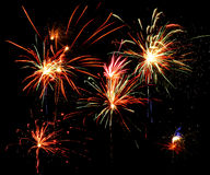 Fireworks. Of various colors bursting against a black background royalty free stock photo