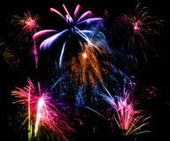 Fireworks. Of various colors bursting against a black background stock photo