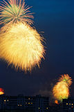 Fireworks. Bright, colorful fireworks explosion in dark sky over city Royalty Free Stock Photos