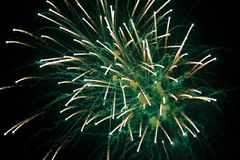 Fireworks. Green fireworks against a dark sky Royalty Free Stock Images