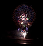 Fireworks. Colorful Fireworks over water at night Royalty Free Stock Image