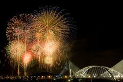 Fireworks. Beautiful fireworks show above a bridge Royalty Free Stock Image