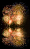 Fireworks. With reflections on water Stock Images