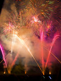 Fireworks. Display with multiple bright bursts Royalty Free Stock Images