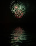 Fireworks. With reflexes on water royalty free stock photography