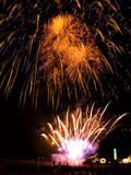 Fireworks. People enjoying the show. Vibrant colors on black. Fireworks series Royalty Free Stock Image