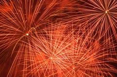 Fireworks. Red fireworks over dark sky stock images