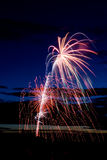 Fireworks. Bright and coloufull fireworks with cloudy night time sky Stock Photography