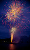 Fireworks. With reflections on river Royalty Free Stock Images