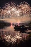 Fireworks above lake royalty free stock photo