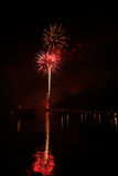 Fireworks above a lake. Stock Images