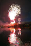 Fireworks above a lake. Stock Photography
