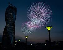 MOSCOW - JUN 23, 2018: Quay with lampposts and Evolution skyscraper, fireworks collage stock photo