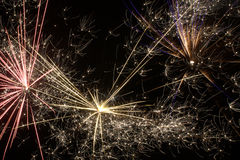 Fireworks against the night sky. 3 different fire works going off Stock Photo