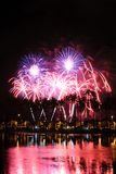 Fireworks at Ala Moana Beach Park. Fireworks exploding behind Palm Trees at Honolulu's Ala Moana Beach park Stock Photos