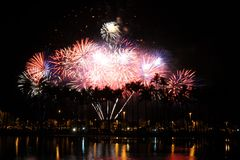 Fireworks at Ala Moana Beach Park. Fireworks exploding behind Palm Trees at Honolulu's Ala Moana Beach park Stock Photography