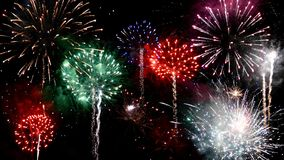 Fireworks in all colors in the night sky stock image