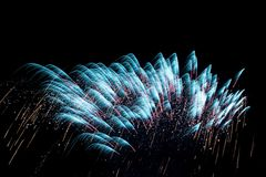 Fireworks background. Blue fireworks background in the sky Royalty Free Stock Photo