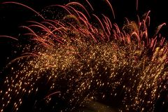 Fireworks background. Red gold fireworks background in the sky Royalty Free Stock Photography