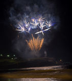 Fireworks by the beach on new year eve. Beautiful and colourful fireworks on the seashore on new year eve at Coogee beach in Sydney, Australia Royalty Free Stock Images