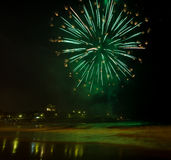 Fireworks by the beach on new year eve. Beautiful and colourful fireworks on the seashore on new year eve at Coogee beach in Sydney, Australia Stock Photo