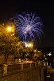 Fireworks upon beautiful historical street close to riverbank Stock Photos