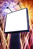 Fireworks billboard. Big blank billboard with colorful firework  in the background Royalty Free Stock Image