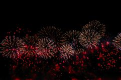 Fireworks on black background for celebration design. Abstract red firework display background. Fireworks on black background for celebration design. Abstract royalty free stock photos