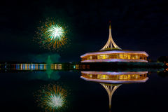 Fireworks on the black sky background with reflection on water a Stock Photo