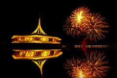 Fireworks on the black sky background with reflection on water a Royalty Free Stock Photo