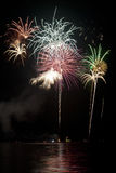 Fireworks on black sky with lake Royalty Free Stock Image