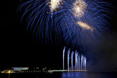 Fireworks in blue. Colour over a lake Royalty Free Stock Image