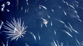 Fireworks in blue sky at night Stock Photography