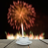 Fireworks blur background and coffee on terrace wood Stock Photography