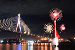 Fireworks and bridge. Fireworks and stay bridge at night scene Royalty Free Stock Photography