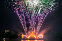 Fireworks in the Buen Retiro Park, Madrid. Fireworks by night in the central source of the Buen Retiro Park, Madrid, during the celebration of San Isidro Royalty Free Stock Photos