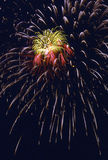 Fireworks Burst. Multiple bursts of firworks with red yellow and white highlights Royalty Free Stock Photo