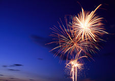 Fireworks Burst. Multiple Fireworks bursting in the dusk sky stock images