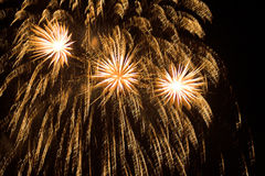 Fireworks Bursting. Three exploding rockets - Fireworks on 5th November, Guy Fawkes Stock Images