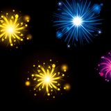 Fireworks bursting in glowing colours yellow blue magenta on black background. Vector illustration Royalty Free Stock Photo